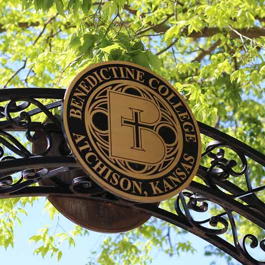 The Benedictine College Seal on the peak of an arch