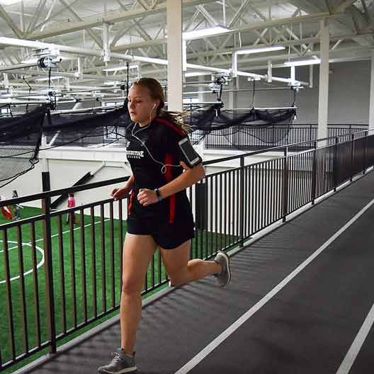 A student running on the Rec Center track