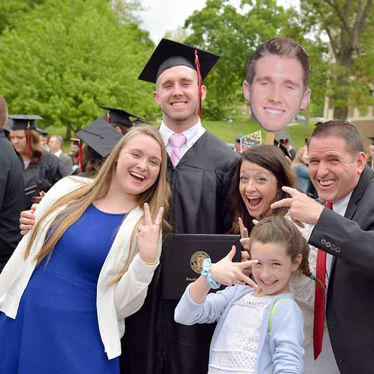 A graduates family celebrates with him