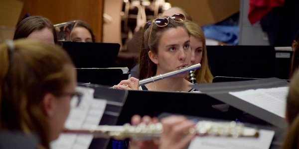 A student plays a woodwind instrument