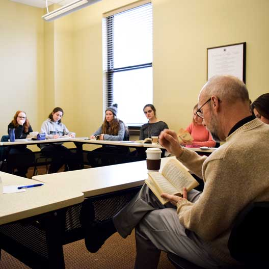 Students in discussion during Dr. George Nicholas' class
