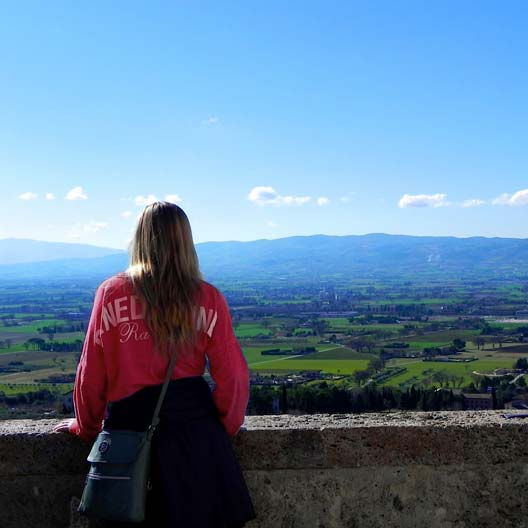 A Benedictine student looking out over an Italian landscape