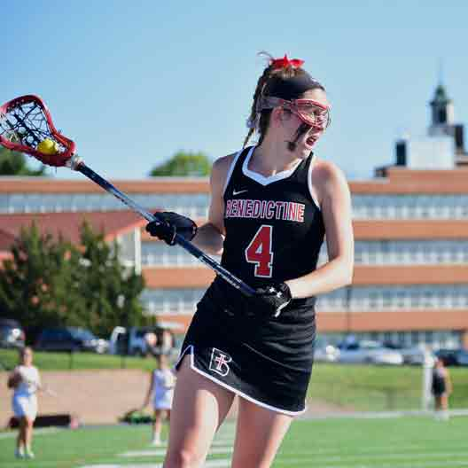 Lady Ravens lacrosse player looking to make a pass