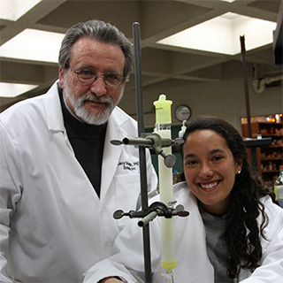 Professor doing science with a student