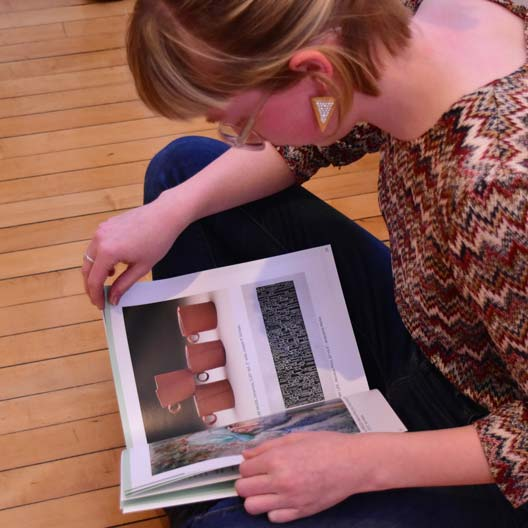 A student reads Loomings Art Magazine