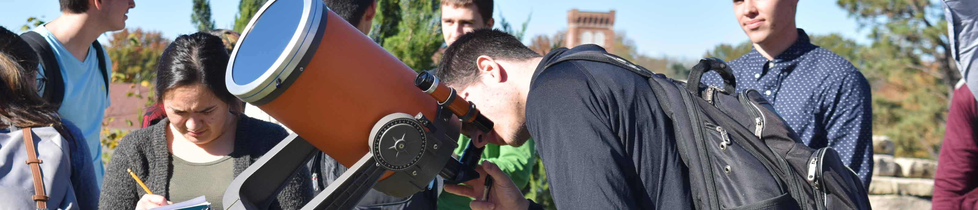Students working with a telescope in Astronomy class
