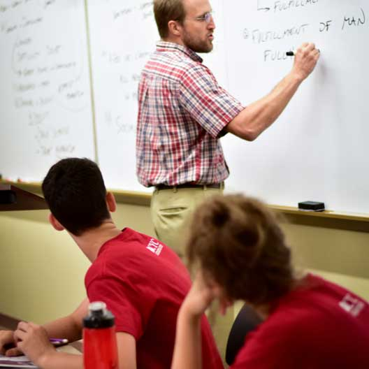 A professor teaches students in BCYC Immersion Evangelization class