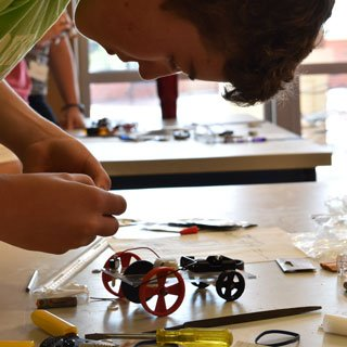 Participant building a miniature car