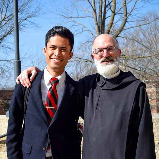 Fr. Gabriel Landis with a student