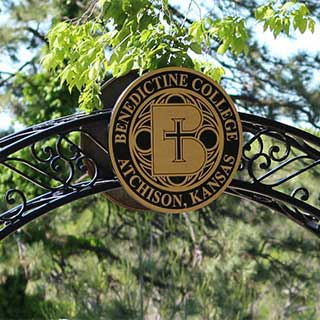The Benedictine College Seal in an iron archway
