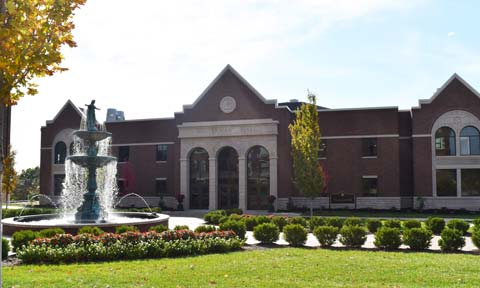 The facade of Westerman Hall, viewed from the quad with Our Lady of Grace Fountain in the foreground