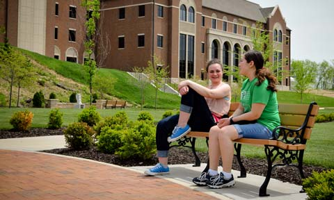 Students sitting in Raven Memorial Park