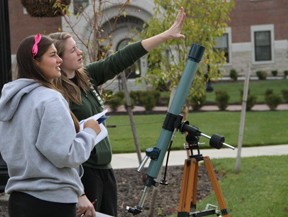 Astronomy Students using a Telescope