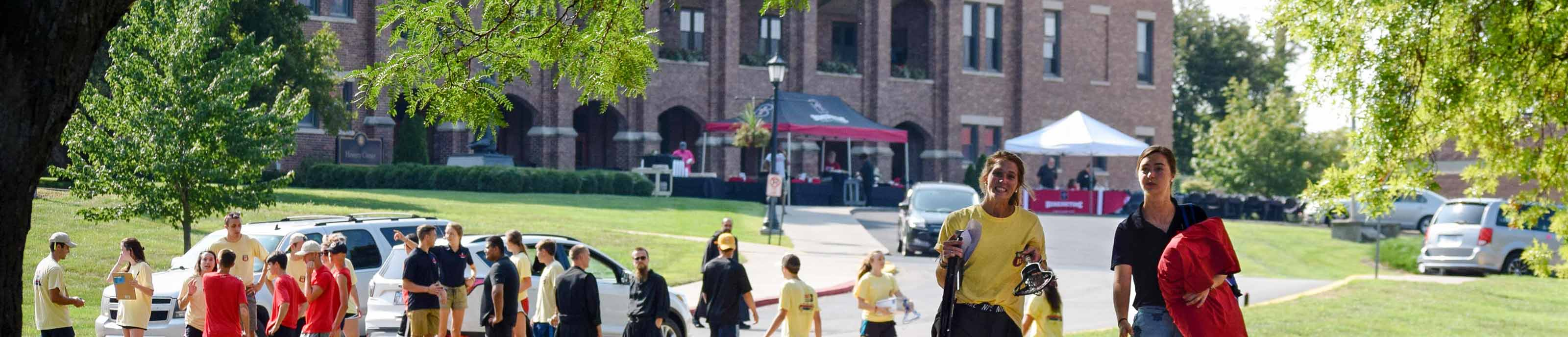 Students, family, monks, and employees busy with move-in day